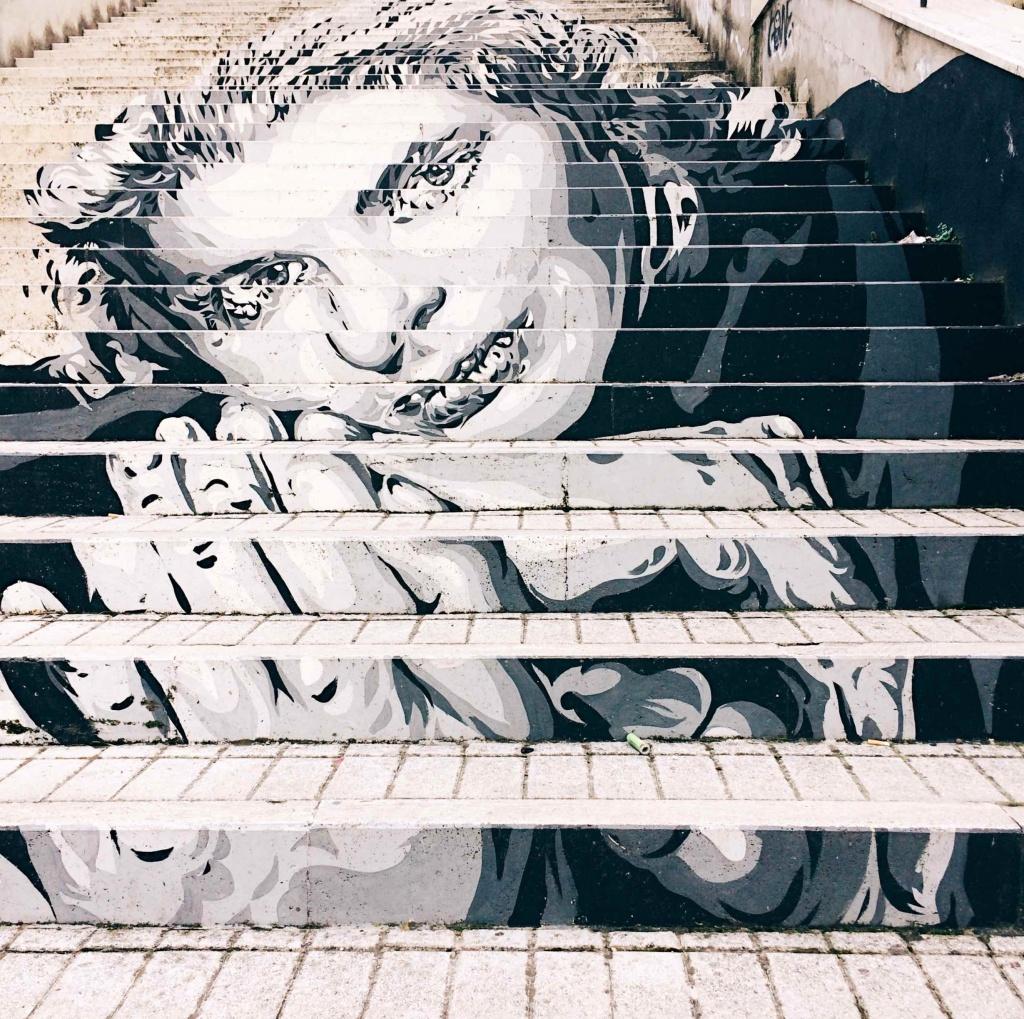 opera street art di Diavù a Roma rappresentante Ingrid Bergman