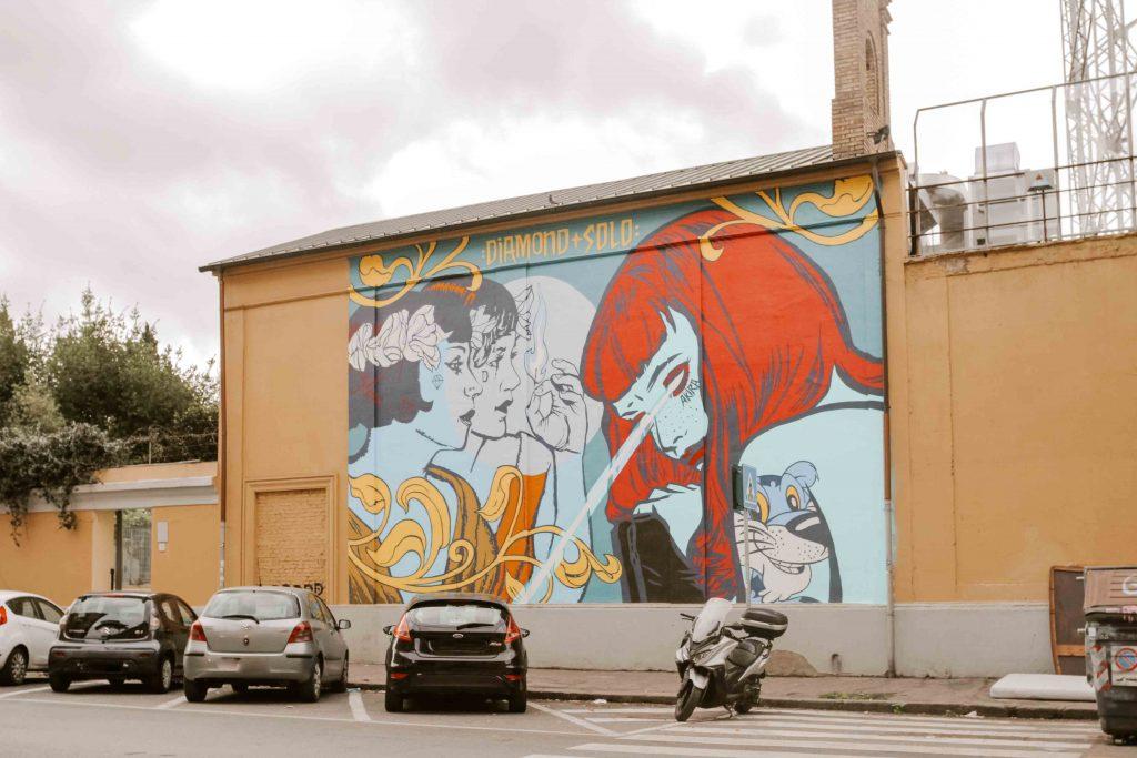 Quartiere Ostiense opera di street art su muro